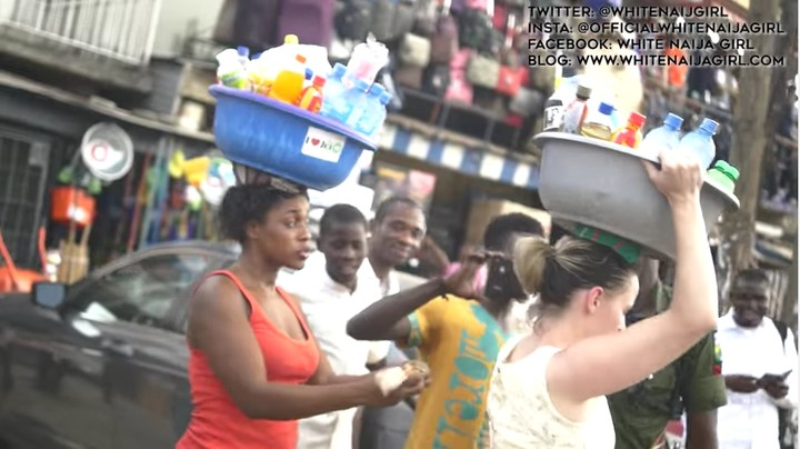 hilarious-video-of-white-woman-selling-pure-water-in-the-street-of-lagos-1